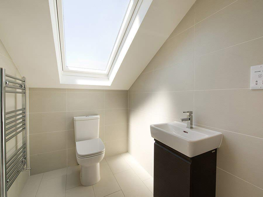 small attic ensuite ideas - Bespoke Lofts A Flawless Finish In South Woodford